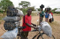 Man Hauling Charcoal on Bike